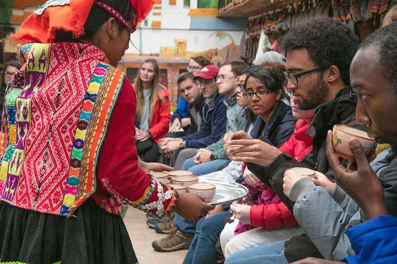 Students take tea in a Peruvian textile factory.